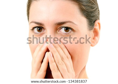 bright closeup picture of woman with hands over mouth - stock photo