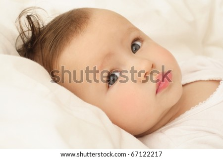 bright closeup portrait of adorable baby - stock photo