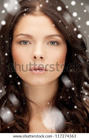 bright closeup portrait picture of beautiful woman with snow - stock photo