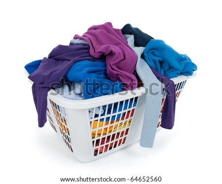 Bright clothes in a laundry basket on white background. Blue, indigo, purple. - stock photo