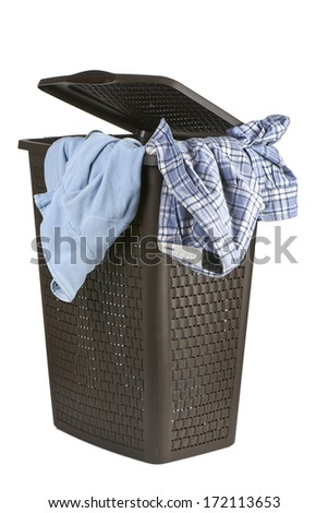 Bright clothes in a laundry open basket on white background - stock photo