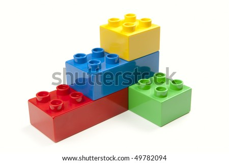 Bright Color Building Blocks Isolated on White. Focus on near edge of bricks with selective focus - stock photo
