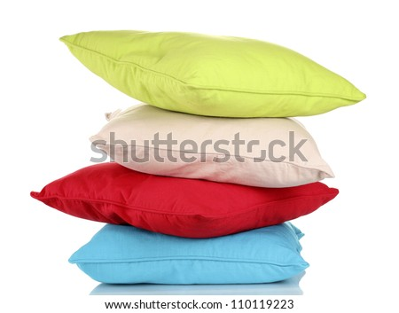 Bright color pillows isolated on white - stock photo