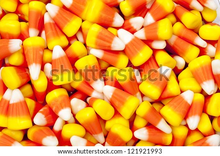 Bright colored candy corn for halloween. - stock photo