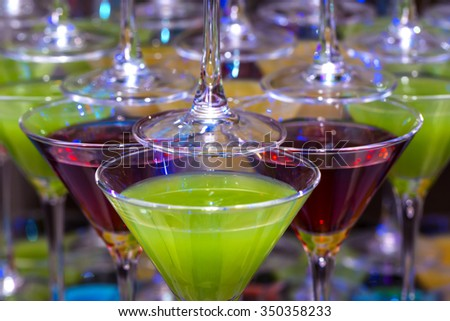 bright colored cocktail with juice and alcohol - stock photo
