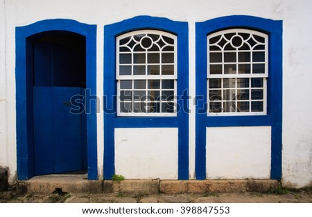 bright colored facade of house at the Parati Brazil - stock photo