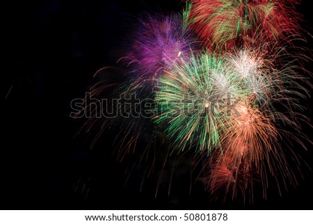 bright colored firework on black night sky - stock photo