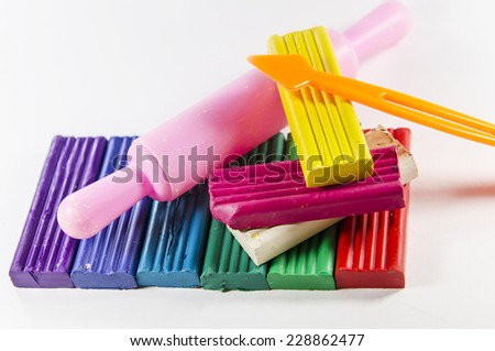 bright colored plasticine with working tools - stock photo