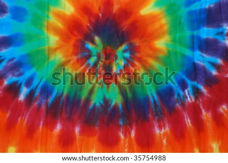 Bright colored tie dye pattern on fabric. - stock photo