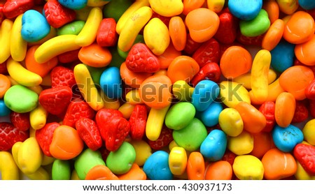 Bright, colorful jellybeans in red, green, pink, blue, yellow and orange colors. - stock photo