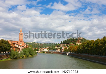 Bright colorful panoramic view of Verona on Adige River Toward Castel San Pietro and the Dominican church of Sant'Anastasia. - stock photo