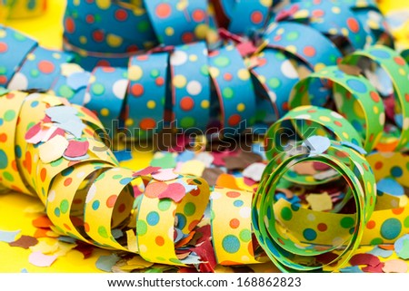 Bright, colorful party streamers and confetti. - stock photo