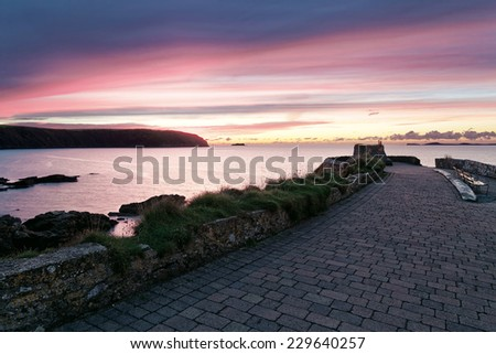 Bright colorful sunset over the sea - stock photo