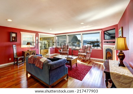 Bright contrast red room with antique furniture and hardwood floor. Real estate in Port Orchard, WA - stock photo