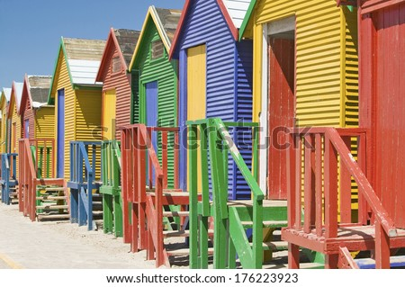 Bright Crayon-Colored Beach Huts at St James, False Bay on Indian Ocean, outside of Cape Town, South Africa - stock photo