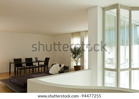 Bright duplex, wide room with large window - stock photo