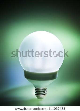 Bright energy saving fluorescent light bulb - stock photo