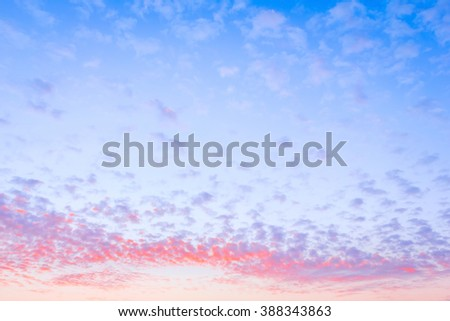 Bright evening light purple clouds on blue sky background before sunset, nature background - stock photo
