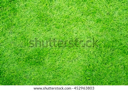 Bright fake green grass lawn - Top view background - stock photo