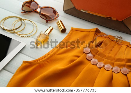 Bright fashion look on wooden background, close up - stock photo