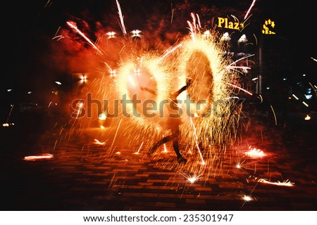 bright fire show at night - stock photo