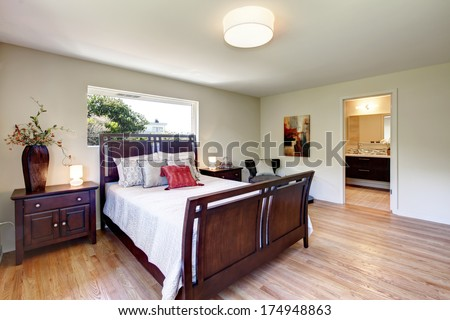 Bright furnished bedroom - stock photo