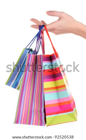 bright gift bags in hand isolated on white - stock photo