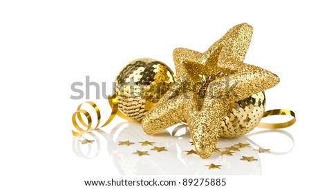 Bright golden christmas decoration with balls and stars with reflection isolated on white background - stock photo