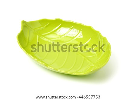 Bright green plastic empty plate on a white background - stock photo