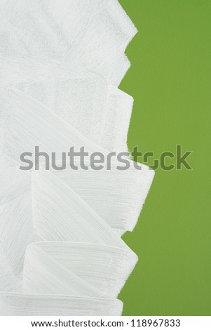 Bright green wall painted in white with paint roller. Brush stroke texture. - stock photo
