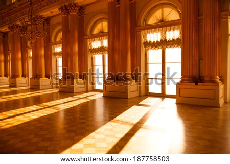 Bright hall in the museum. Sunlight in windows. - stock photo