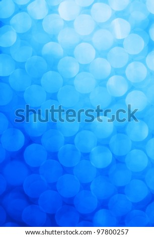 Bright holiday background bokeh with magic blur blue lights - stock photo