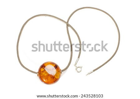Bright honey color amber charm isolated - stock photo