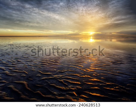 Bright horizon at sunset with ocean ripples - stock photo