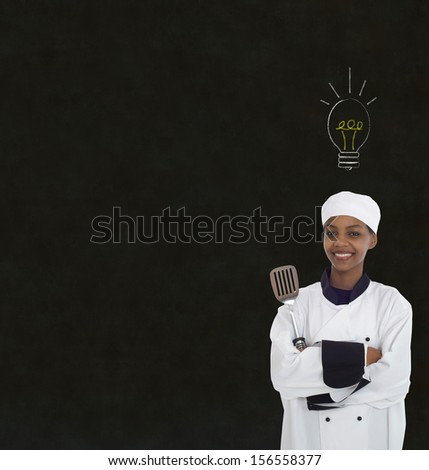 Bright idea lightbulb thinking African or African American woman chef on chalk blackboard background - stock photo