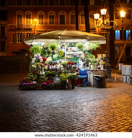 bright illuminated flower stand at night in the streets of Rome, Italy, Europe - stock photo