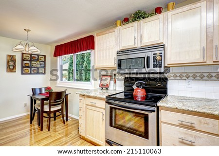 Bright kitchen room with cozy dining area. - stock photo