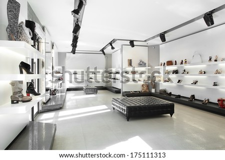 bright large shoe store with luxury collection - stock photo