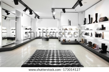 Bright large shoe store with new collection - stock photo