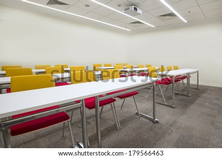 Bright lecture hall with TV projector - stock photo