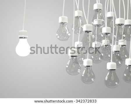 Bright light bulb with regular light bulbs - stock photo