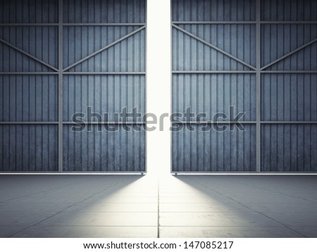 Bright light in open hangar doors - stock photo