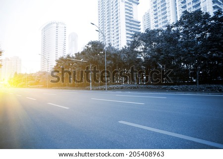 bright light in the empty street at night - stock photo