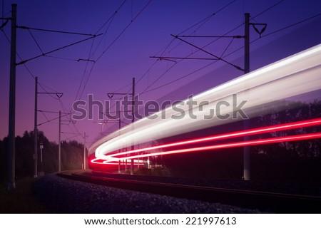 bright line passing night train - stock photo