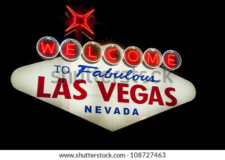 Bright lit Welcome Las Vegas sign under the night sky - stock photo