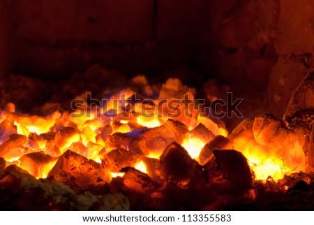 bright live coals smoldering in the stove - stock photo