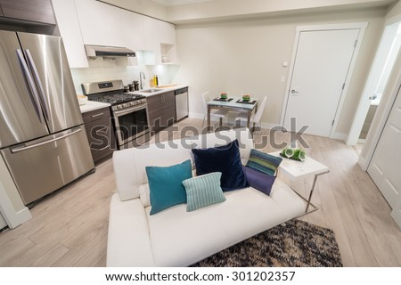 Bright living room with kitchen and dinner table. Interior design. - stock photo