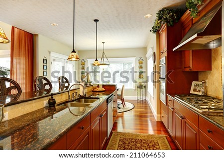 Bright luxury kitchen with granite tops. - stock photo