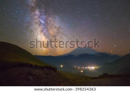 Bright Milky way and stars over Mount Elbrus - stock photo