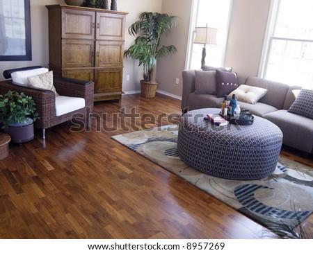 Bright modern interior Design with hard wood flooring - stock photo